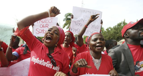 Nigerians take part in a protest demanding for the release of secondary school girls abducted from the remote village of Chibok, in Asokoro district in Abuja, Nigeria on May 13, 2014. /Reuters