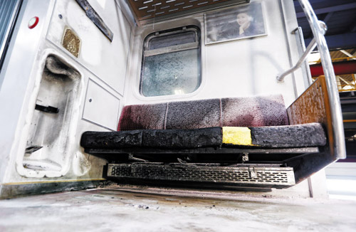 Seats in a subway car are charred after arson at Dogok Station on Subway Line No. 3 in Seoul on Wednesday.