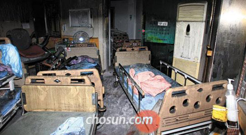 Beds and fixtures are blackened after a fire in a hospital in Jangseong, South Jeolla Province on Wednesday.