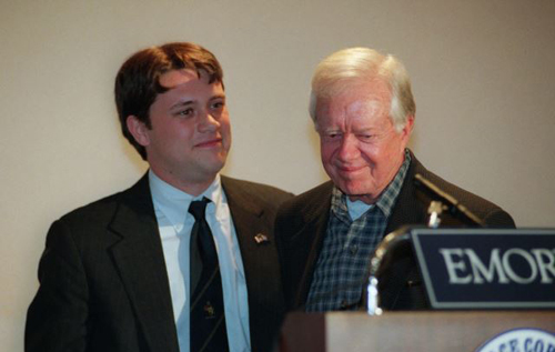Former President Jimmy Carter (right) smiles after being introduced by grandson Jason Carter during a symposium on South Africa sponsored by the Peace Corps at Emory University in Atlanta. /AP