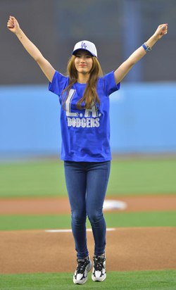 Su-zy of girl band miss A reacts after throwing the ceremonial first pitch in a game between the Los Angeles Dodgers and Cincinnati Reds at Dodger Stadium in Los Angeles on Wednesday.