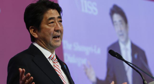 Japans Prime Minister Shinzo Abe delivers the opening keynote address for the 13th International Institute for Strategic Studies (IISS) Asia Security Summit: The Shangri-La Dialogue, in Singapore on May 30, 2014. /Reuters