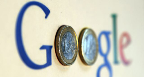 An illustration picture shows a Google logo with two one Euro coins, taken in Munich. /Reuters