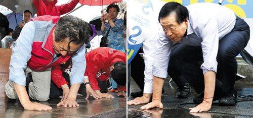 Seoul mayoral candidates bow in the rain in Seoul on Tuesday, a day ahead of the local elections -- Saenuri Party candidate Chung Mong-joon (left) near Hagye subway station, and incumbent Mayor Park Won-soon, the candidate for the opposition New Politics Alliance for Democracy, in Sindang-dong.