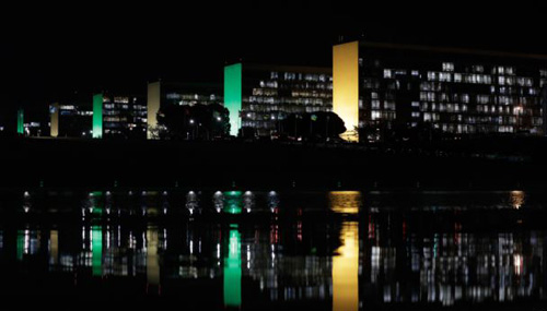 A general view of the Esplanada dos Ministerios, decorated with green and yellow light, the national colors of Brazil, in honor of FIFA World Cup, in Brasilia, Brazil on June 2, 2014. /AP