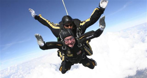 Former President George H.W. Bush during free fall with U.S. Army Golden Knights parachute team member, Sgt. 1st Class Mike Elliott, College Station, Texas in November 2007. /AP