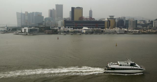 A ferry sails across the Casino Sands Macau on Dec. 19, 2009. /AP