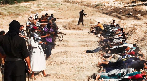 This image appears to show ISIL militants taking aim at captured Iraqi soldiers. It was posted on a militant website June 14, 2014. /AP