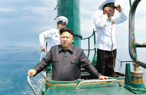 North Korean leader Kim Jong-un stands in the conning tower of a submarine in this picture published by the official Rodong Sinmun daily on Monday.