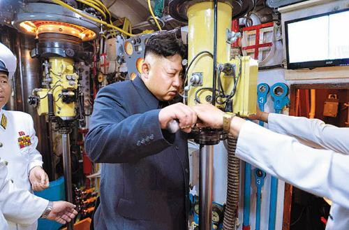 North Korean leader Kim Jong-un looks into a periscope aboard a submarine in this picture published by the official Rodong Sinmun daily on Monday.