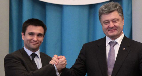 Ukrainian President Petro Poroshenko (right) congratulates new Ukrainian Foreign Minister Pavel Klimkin in Kyiv on June 19, 2014. /AP