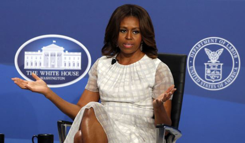 First lady Michelle Obama speaks at The White House Summit on Working Families at a hotel in Washington on June 23, 2014. /AP