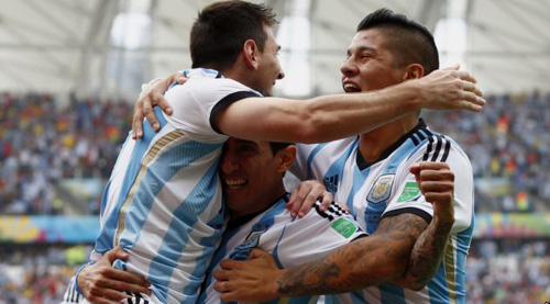 Argentinas Lionel Messi (left) celebrates with teammates Angel Di Maria and Marcos Rojo after scoring against Nigeria during their 2014 World Cup Group F soccer match at the Beira Rio stadium in Porto Alegre on June 25, 2014. /AP