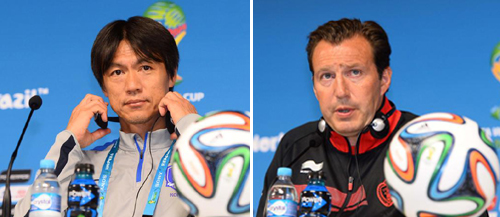 Koreas national team manger Hong Myung-bo (left) and Belgiums head coach Marc Wilmots answer reporters questions the day before the group H World Cup soccer match between Korea and Belgium at a stadium in São Paulo, Brazil on Wednesday.