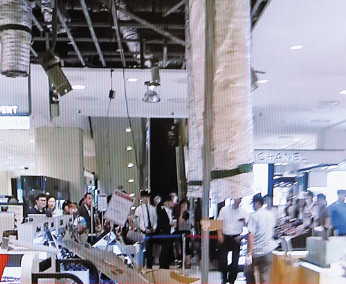 People are being evacuated after plasterboard suddenly fell off the ceiling on the ground floor of Hyundai Department Store in southeastern Seoul on Sunday, in this screen grab from YTN news. /News 1
