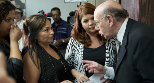 Kenneth Feinberg, the independent claims administrator for the GM Ignition Compensation Program (right) meets with family members of crash victims in Washington on June 20, 2014. /AP
