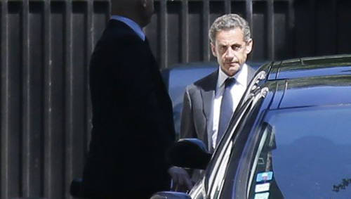 Former French President Nicolas Sarkozy leaves his residence in Paris on July 2, 2014. /Reuters