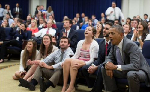 President Barack Obama and staff watch the U.S. soccer team vs. Belgium in World Cup action in the Eisenhower Executive Office Building South Court Auditorium on July 1, 2014. /Courtesy of White House