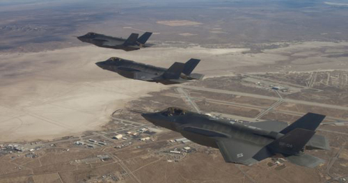 Three F-35 Joint Strike Fighters fly over Edwards Air Force Base. /AP