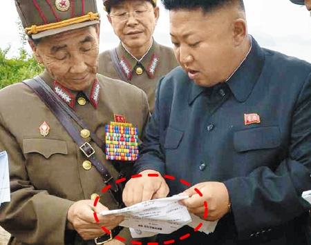 North Korean leader Kim Jong-un reads a document during his inspection of a military drill in Wonsan, Kangwon Province, in this photo published in the official Rodong Sinmun on Saturday.