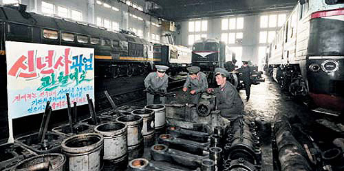 North Korean workers repair trains in a carport in Pyongyang in this photo released by the Rodong Sinmun daily.