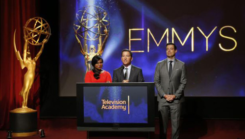Television Academy Chairman & CEO Bruce Rosenblum (center), actress Mindy Kaling (left) and television host Carson Daly stand together during the nominations announcement for the 66th Primetime Emmy Awards in North Hollywood, California on July 10, 2014. /Reuters