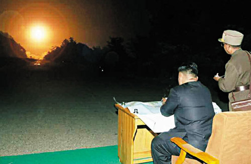 North Korean leader Kim Jong-un watches a rocket launch drill in this photo published by the Rodong Sinmun on Thursday.