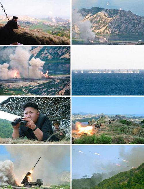 North Korean leader Kim Jong-un watches a rocket launch drill in these photos published by the Rodong Sinmun on Tuesday. /News1