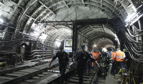 In this photo taken on July 15, 2014 rescuers carry a stretcher with a victim from a tunnel after a train derailed between two subway stations in Moscow, Russia. /AP