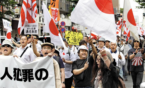 Rightwing Japanese activists demonstrate against ethnic Koreans living in Japan, in Tokyo in May 2013. /AP-Newsis