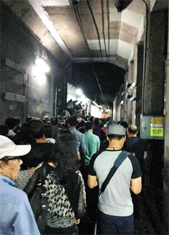 Passengers escape to safety after a fire broke out on a subway in Busan on Thursday. /News1