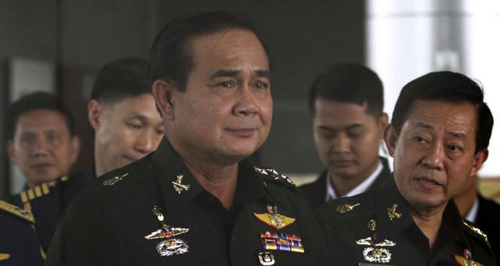 Thailands Army commander Gen. Prayuth Chan-ocha (left) arrives at the Royal Thai Army Club in Bangkok, Thailand. /AP