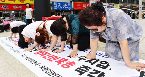 Activists protest in front of Chinese Embassy in Seoul on July 2, a day ahead of Chinese President Xi Jinpings visit to South Korea, urging the Chinese government to stop repatriating North Korean defectors. /News 1