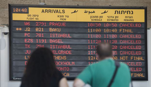 Arrival flight board displays various canceled and delayed flights in Ben Gurion International airport a day after the U.S. Federal Aviation Administration imposed a 24-hour restriction on flights to the region on July 23, 2014. /AP