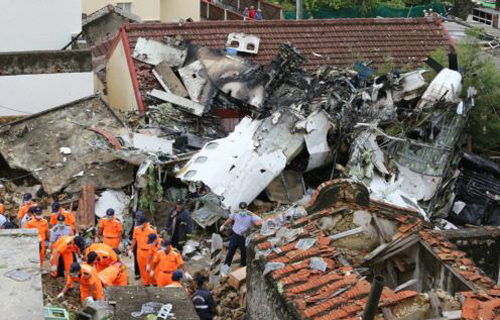 Rescue workers survey the wreckage of TransAsia Airways Flight GE222 on the Taiwanese island of Penghu on July 24, 2014. /AP