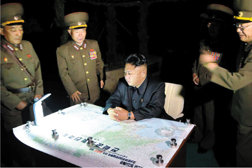 North Korean leader Kim Jong-un directs a rocket launch in Jangsangot, Hwanghae Province on Saturday, in this undated photo released by Rodong Sinmun on Sunday.