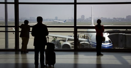 Passengers wait to board their plane at Shanghais Hongqiao International Airport. /Reuters