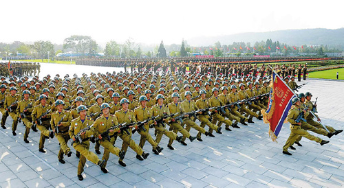 North Korean soldiers march to mark the 61st anniversary of the armistice of the Korean War at the Kumsusan Palace of the Sun in Pyongyang on Sunday, in this picture published by the Rodong Sinmun.