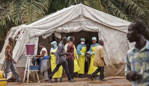 Health workers prescreen people for the deadly Ebola virus before they enter the Kenema Government Hospital in Kenema, Sierra Leone. /AP