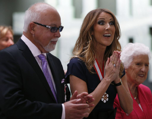 Celine Dion, who with husband Rene Angelil received Order of Canada awards last year, is suspending her singing career to focus on family and health. /Reuters
