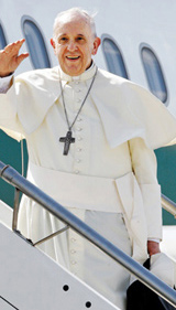 Pope Francis waves as he boards a plane on his way to Korea, at Romes Fiumicino International Airport on Wednesday. /AP-Newsis