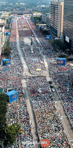 The Gwanghwamun area in Seoul is packed with people on Saturday ahead of a mass by Pope Francis.