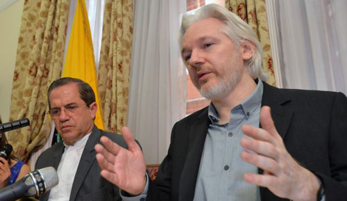 Ecuadors Foreign Minister Ricardo Patino (left) and WikiLeaks founder Julian Assange speak during a press conference inside the Ecuadorian Embassy in London on Aug. 18, 2014. /AP