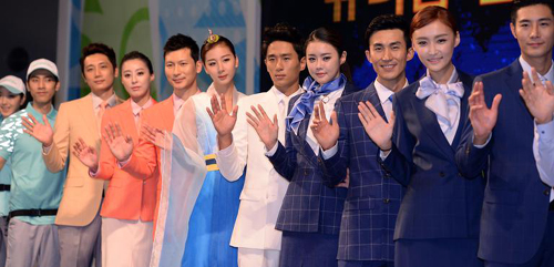 Volunteers for the 2014 Incheon Asian Games pose in official uniform at a gymnasium in Incheon on Tuesday. /Newsis