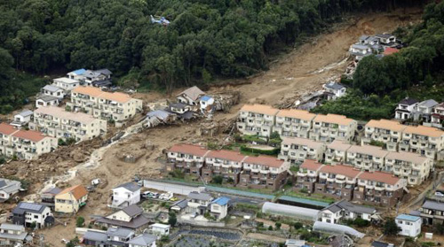 An aerial view shows a landslide that swept through a residential area at Asaminami ward in Hiroshima, western Japan, in this photo taken by Kyodo on Aug. 20, 2014. /Reuters