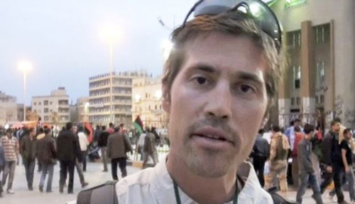 This undated image, from video released by GlobalPost on April 7, 2011, shows journalist James Foley in Benghazi, Libya. /AP