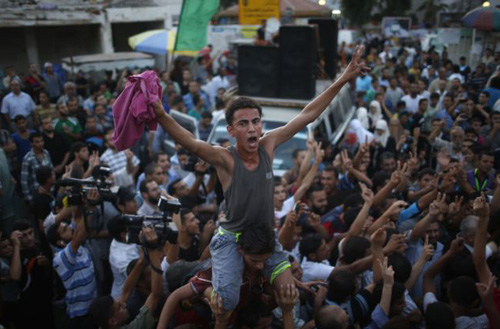 Palestinians celebrate following announcement of a ceasefire in Gaza City on Aug. 26, 2014. /Reuters