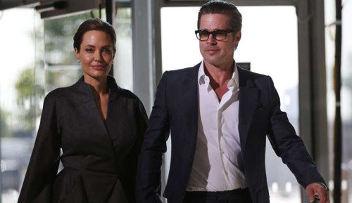 U.S. actress Angelina Jolie and partner actor Brad Pitt (file photo) /AP