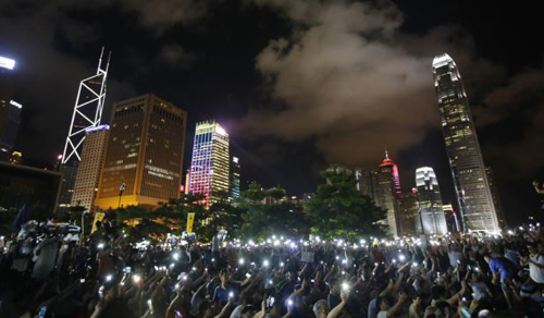 Protesters wave their mobile phones during a rally, after Chinas legislature has ruled out open nominations in elections for Hong Kongs leader in Hong Kong on Aug. 31, 2014. /AP
