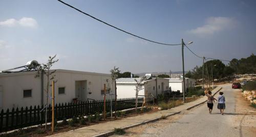 Israeli women walk in a Jewish settlement known as